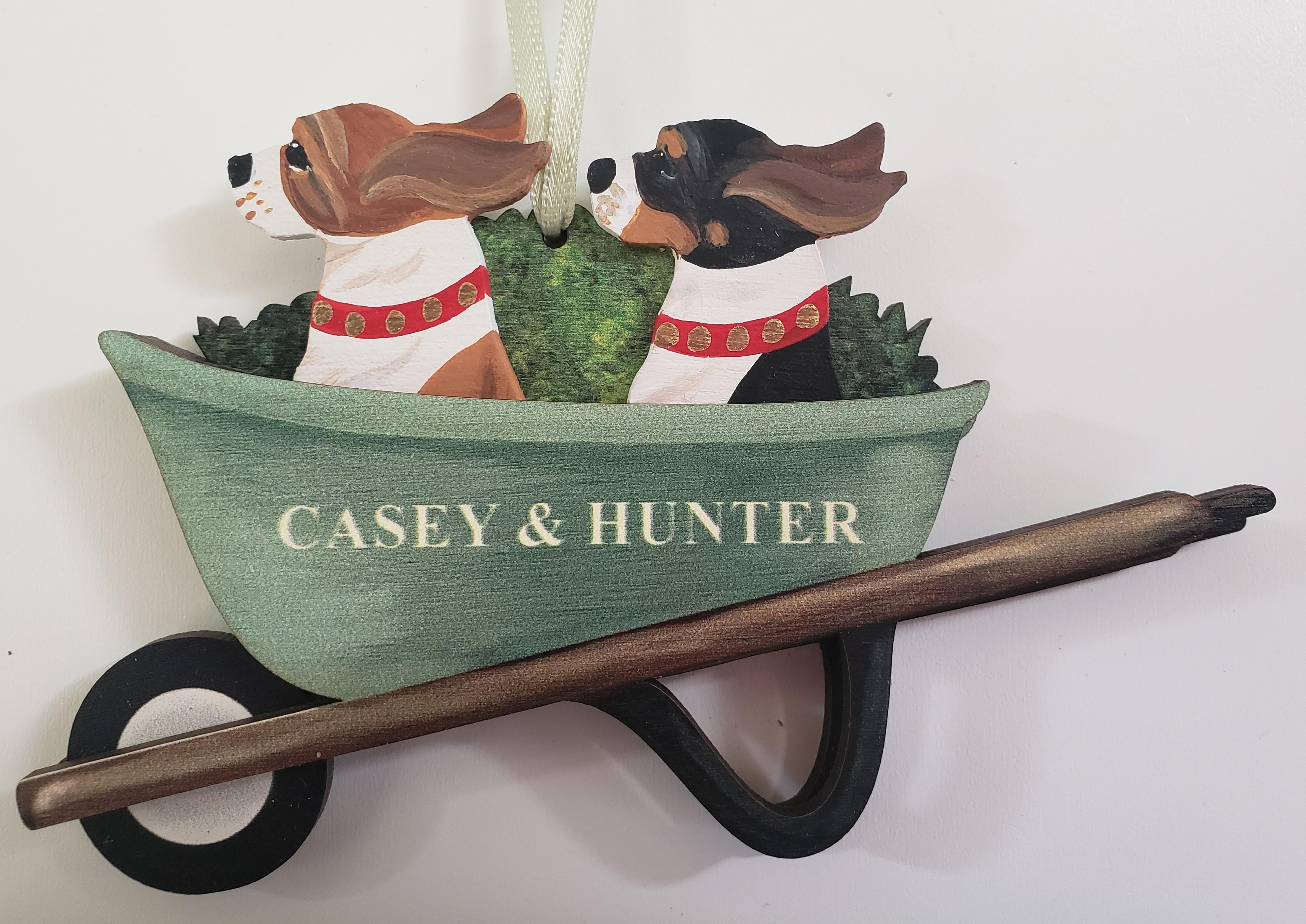 GREEN VINTAGE WHEELBARROW. 2 DOGS