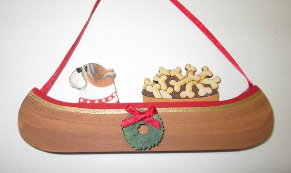 Holiday Canoe Dog On The Move ornament with Bushel of Bones